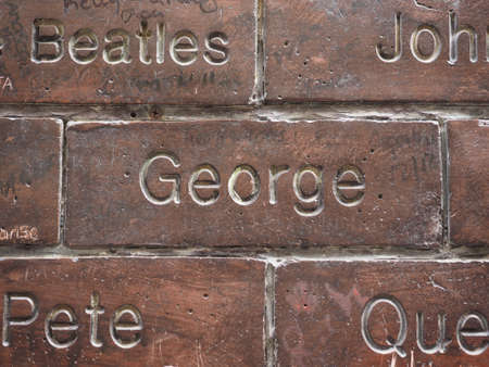 the beatles: LIVERPOOL, UK - CIRCA JUNE 2016: The Wall of Fame at the Cavern Pub opposite the Cavern Club where The Beatles played. Detail of George Harrison tile.