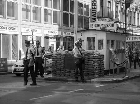 east berlin: BERLIN, GERMANY - CIRCA JUNE 2016: Checkpoint Charlie (aka Checkpoint C) wall crossing point between East Berlin and West Berlin during the Cold War in black and white Editorial