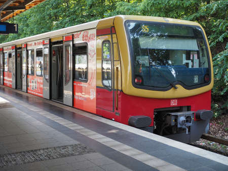 strain: BERLIN, GERMANY - CIRCA JUNE 2016: S-bahn (meaning S-train), abbreviation of Stadtbahn (meaning City train) electrified hybrid urban and suburban railway