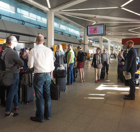 queueing: BERLIN, GERMANY - CIRCA JUNE 2016: People queueing at Berlin Tegel airport waiting for checkin Editorial