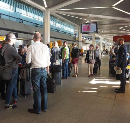 checkin: BERLIN, GERMANY - CIRCA JUNE 2016: People queueing at Berlin Tegel airport waiting for checkin Editorial