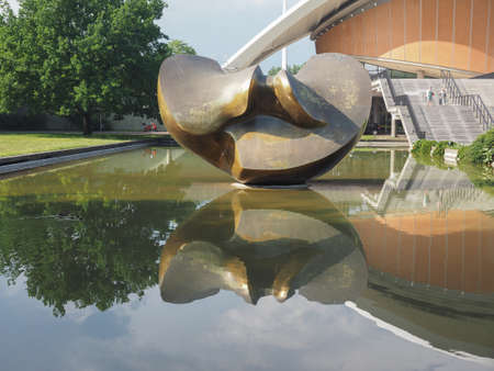 titled: BERLIN, GERMANY - CIRCA JUNE 2016: Sculpture titled Large Divided Oval Butterfly by sculptor Henry Moore in front of the Haus der Kulturen der Welt (meaning House of the Cultures of the World) Editorial