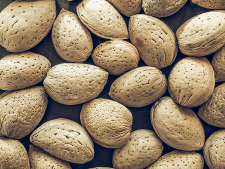 desaturated: Vintage desaturated Detail of dried Almonds fruit food useful as background Stock Photo