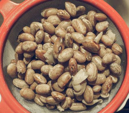 borlotti beans: Vintage desaturated Borlotti beans vegetables in a colander