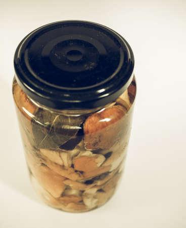 cep: Vintage desaturated Boletus edulis aka penny bun or porcino or cep mushrooms in a glass jar