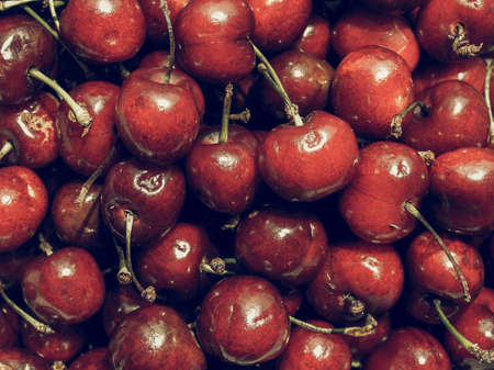 desaturated: Vintage desaturated Red cherry fruit healthy - useful as a background Stock Photo