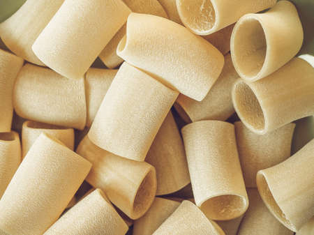 maccheroni: Vintage desaturated Italian paccheri pasta in the shape of large tubes from Campania and Calabria
