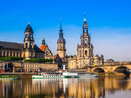 High dynamic range HDR Dresden Cathedral of the Holy Trinity aka Hofkirche Kathedrale Sanctissimae Trinitatis in Dresden Germany seen from the Elbe river Stock Photo