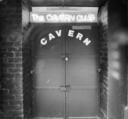 the beatles: LIVERPOOL, UK - CIRCA JUNE 2016: The Cavern Club nightclub at 10 Mathew Street where The Beatles played in black and white