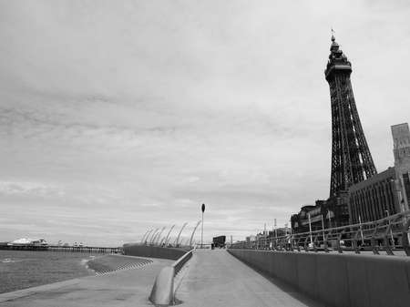 amusement park black and white: BLACKPOOL, UK - CIRCA JUNE 2016: Blackpool Pleasure Beach resort and Blackpool Tower on the Fylde coast in Lancashire in black and white Editorial
