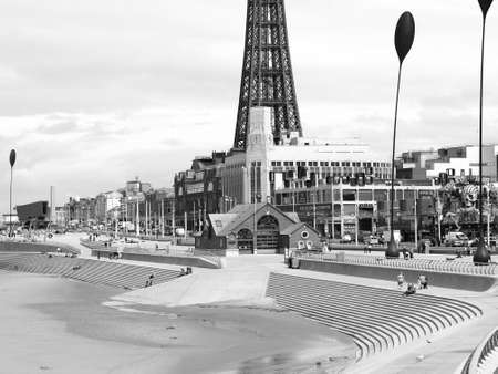 lancashire: BLACKPOOL, UK - CIRCA JUNE 2016: Blackpool Pleasure Beach resort and Blackpool Tower on the Fylde coast in Lancashire in black and white Editorial