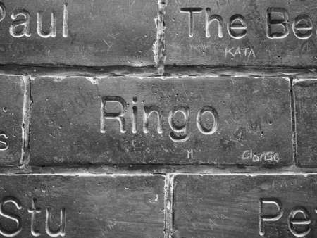 the beatles: LIVERPOOL, UK - CIRCA JUNE 2016: The Wall of Fame at the Cavern Pub opposite the Cavern Club where The Beatles played. Detail of Ringo Starr tile. in black and white