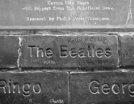 played: LIVERPOOL, UK - CIRCA JUNE 2016: The Wall of Fame at the Cavern Pub opposite the Cavern Club where The Beatles played in black and white