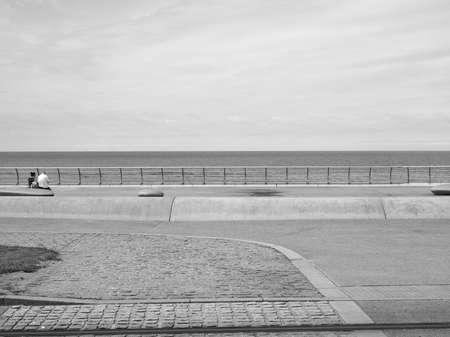 lancashire: BLACKPOOL, UK - CIRCA JUNE 2016: Blackpool Pleasure Beach resort amusement park on the Fylde coast in Lancashire in black and white