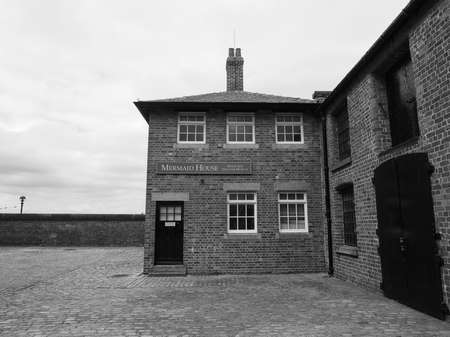 sea nymph: LIVERPOOL, UK - CIRCA JUNE 2016: The Mermaid House, part of Merseyside Maritime Museum in the Albert Dock in black and white