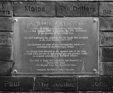 the beatles: LIVERPOOL, UK - CIRCA JUNE 2016: The Wall of Fame at the Cavern Pub opposite the Cavern Club where The Beatles played in black and white
