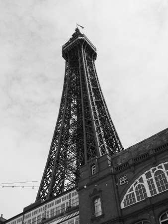 amusement park black and white: BLACKPOOL, UK - CIRCA JUNE 2016: Blackpool Tower on Blackpool Pleasure Beach resort amusement park on the Fylde coast in black and white