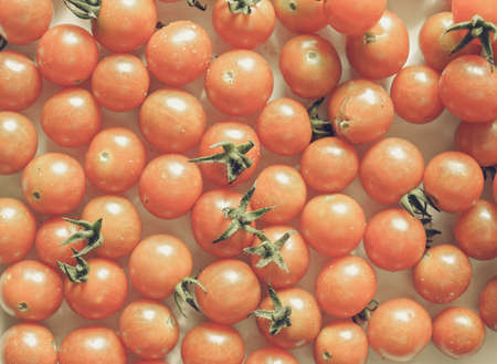 desaturated: Vintage desaturated Red cherry tomato vegetables useful as background