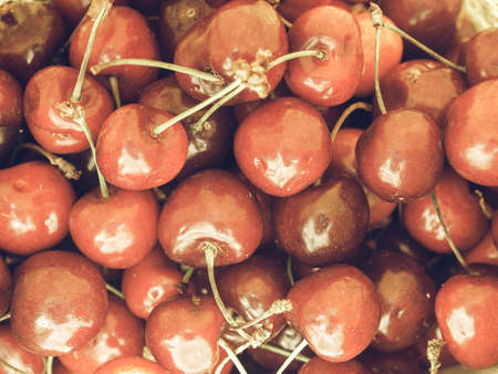 desaturated: Vintage desaturated Red cherries fruits useful as a backgroun