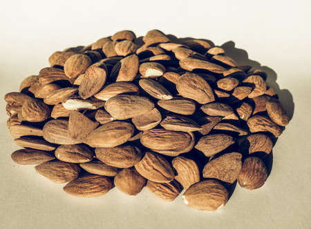 desaturated: Vintage desaturated Heap of almonds dried fruit food useful