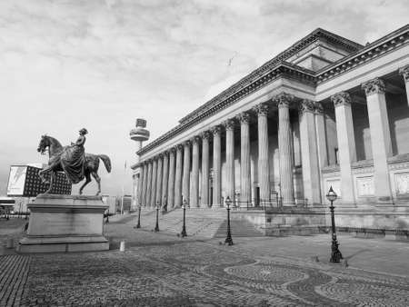 queen victoria: LIVERPOOL, UK - CIRCA JUNE 2016: Queen Victoria equestrial statue in front of St George Hall in black and white Editorial