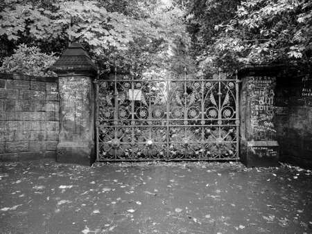 the beatles: LIVERPOOL, UK - CIRCA JUNE 2016: Strawberry Field gate in Beaconsfield Road in Woolton made famous by The Beatles song Strawberry Fields Forever on their 1967 album Magical Mystery Tour in black and white Editorial