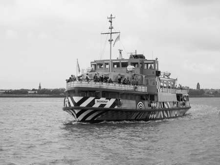 LIVERPOOL, UK - CIRCA JUNE 2016: Ferry across the Mersey river in black and white