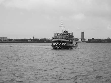 across: LIVERPOOL, UK - CIRCA JUNE 2016: Ferry across the Mersey river in black and white