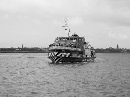 mersey: LIVERPOOL, UK - CIRCA JUNE 2016: Ferry across the Mersey river in black and white