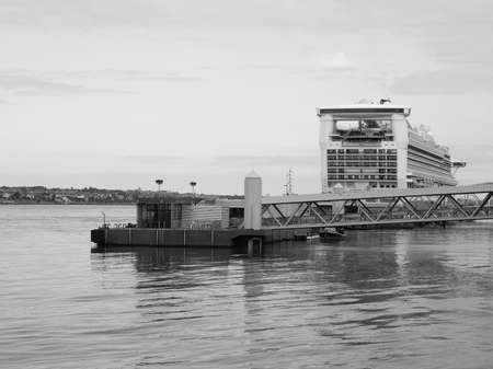 mersey: LIVERPOOL, UK - CIRCA JUNE 2016: Pier Head terminal of the Mersey Ferries service operating on the River Mersey in black and white