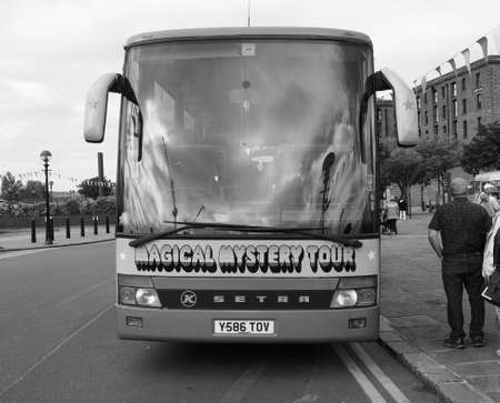 the beatles: LIVERPOOL, UK - CIRCA JUNE 2016: The Beatles Magical Mystery Tour bus in black and white