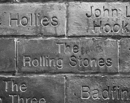 the beatles: LIVERPOOL, UK - CIRCA JUNE 2016: The Wall of Fame at the Cavern Pub opposite the Cavern Club where The Beatles played. Detail of The Rolling Stones tile. in black and white