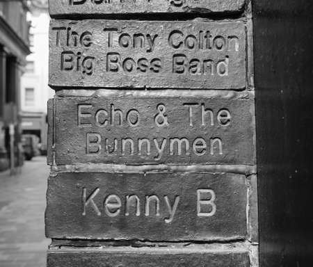 played: LIVERPOOL, UK - CIRCA JUNE 2016: The Wall of Fame at the Cavern Pub opposite the Cavern Club where The Beatles played. Detail of Echo and the Bunnymen tile. in black and white