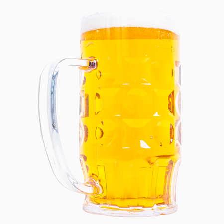 hdr background: High dynamic range (HDR) Large German bierkrug beer mug tankard glass, half litre, one pint of Lager - isolated over white background