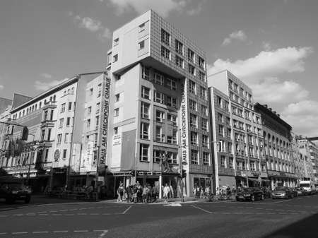 BERLIN, GERMANY - CIRCA JUNE 2016: Checkpoint Charlie (aka Checkpoint C) wall crossing point between East Berlin and West Berlin during the Cold War in black and white Editorial