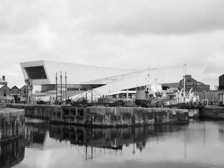 liverpool: LIVERPOOL, UK - CIRCA JUNE 2016: The Museum of Liverpool designed by Danish architects 3XN at Pier Head part of Liverpool Maritime Mercantile City in black and white
