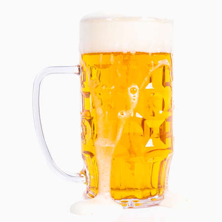 litre: High dynamic range (HDR) Large German bierkrug beer mug tankard glass of Lager - isolated over white background