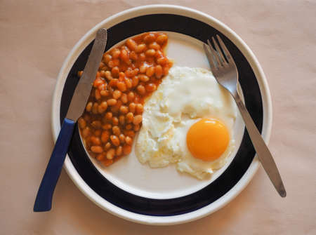 uk cuisine: Vegetarian English breakfast with baked beans and fried egg Stock Photo