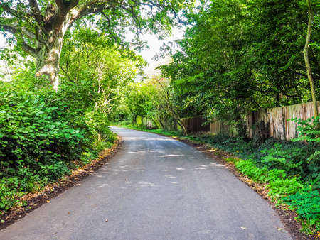 High dynamic range HDR Road in the English countryside in Tanworth in Arden Warwickshire, UK Stock Photo