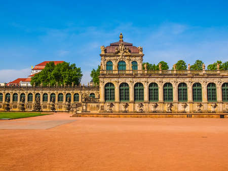 designed: High dynamic range HDR Dresdner Zwinger rococo palace designed by Poeppelmann in 1710 as orangery and exhibition gallery of Dresden Court completed by Gottfried Semper with the addition of the Semper Gallery in 1847