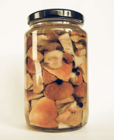 edulis: Vintage desaturated Boletus edulis aka penny bun or porcino or cep mushrooms in a glass jar