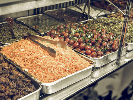 food shop: Vintage desaturated Take away food shop with vegetables, carrots and tomatoes Stock Photo