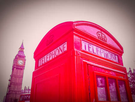 ancient telephone: High dynamic range HDR Vintage looking Traditional red telephone box in London UK Stock Photo