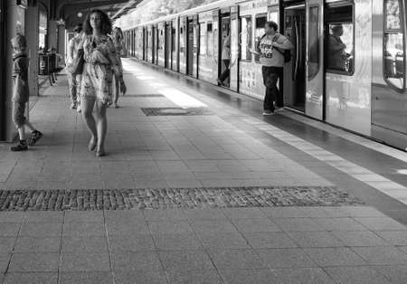 strain: BERLIN, GERMANY - CIRCA JUNE 2016: S-bahn (meaning S-train), abbreviation of Stadtbahn (meaning City train) electrified hybrid urban and suburban railway in black and white