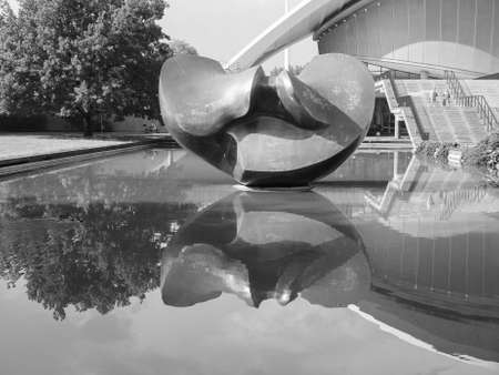 henry: BERLIN, GERMANY - CIRCA JUNE 2016: Sculpture titled Large Divided Oval Butterfly by sculptor Henry Moore in front of the Haus der Kulturen der Welt (meaning House of the Cultures of the World) in black and white