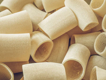 desaturated: Vintage desaturated Italian paccheri pasta in the shape of large tubes from Campania and Calabria