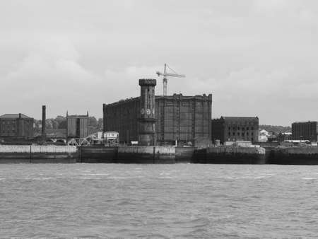 View of Birkenhead skyline across the Mersey river in Liverpool, UK in black and white