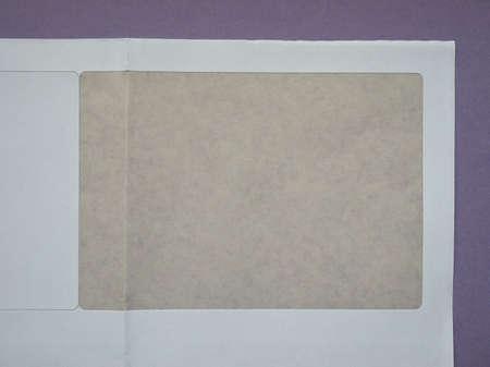 white sheet: Detail of a white paper sheet label