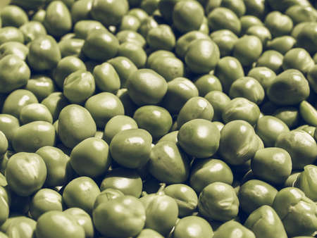 desaturated: Vintage desaturated Green peas beans useful as a background Stock Photo