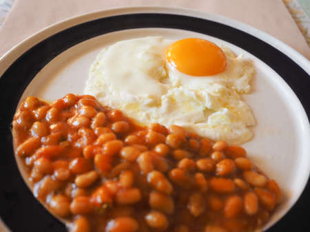 english breakfast: Vegetarian English breakfast with baked beans and fried egg Stock Photo
